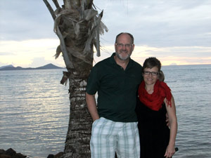 Dr. Coston and Cynthia in Chuuk, Micronesia, at sunset